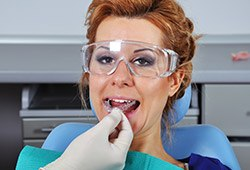 Woman having oral appliance fitted