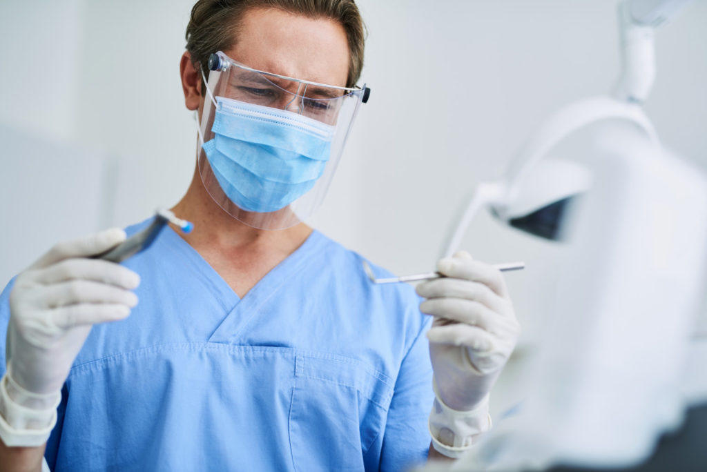 Dentist in Stephens City wears protective equipment.