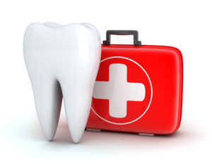 Giant tooth next to red dental emergency kit