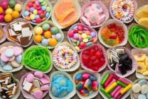 cupcake tins filled with different kinds of candy