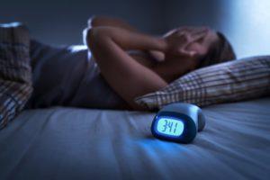 woman awake struggling with sleep apnea